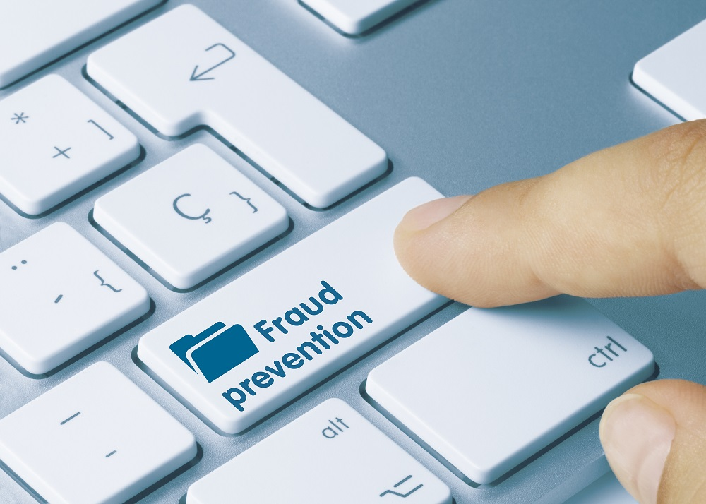 Finger on a Keyboard that Says Fraud Prevention
