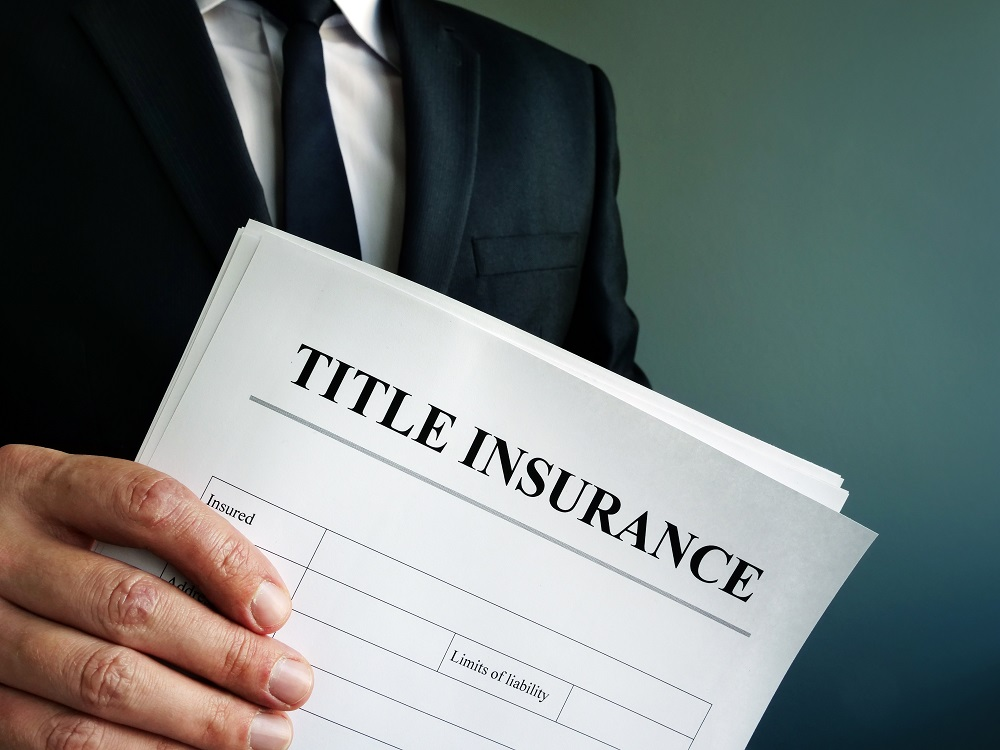 Man Holding Title Insurance Form