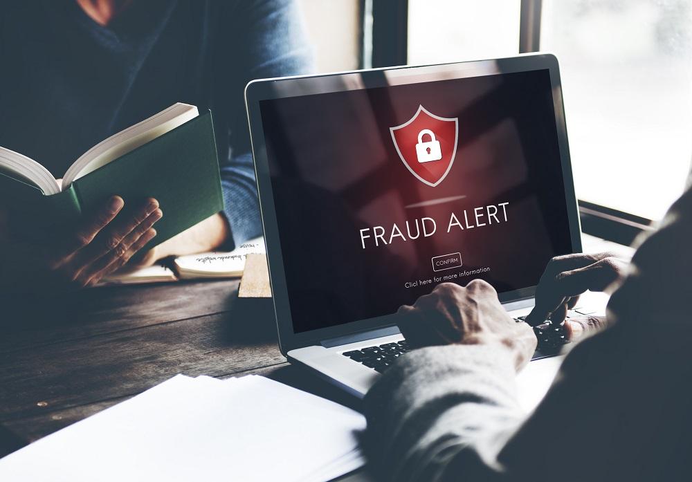 Fraud Alert on Laptop Screen